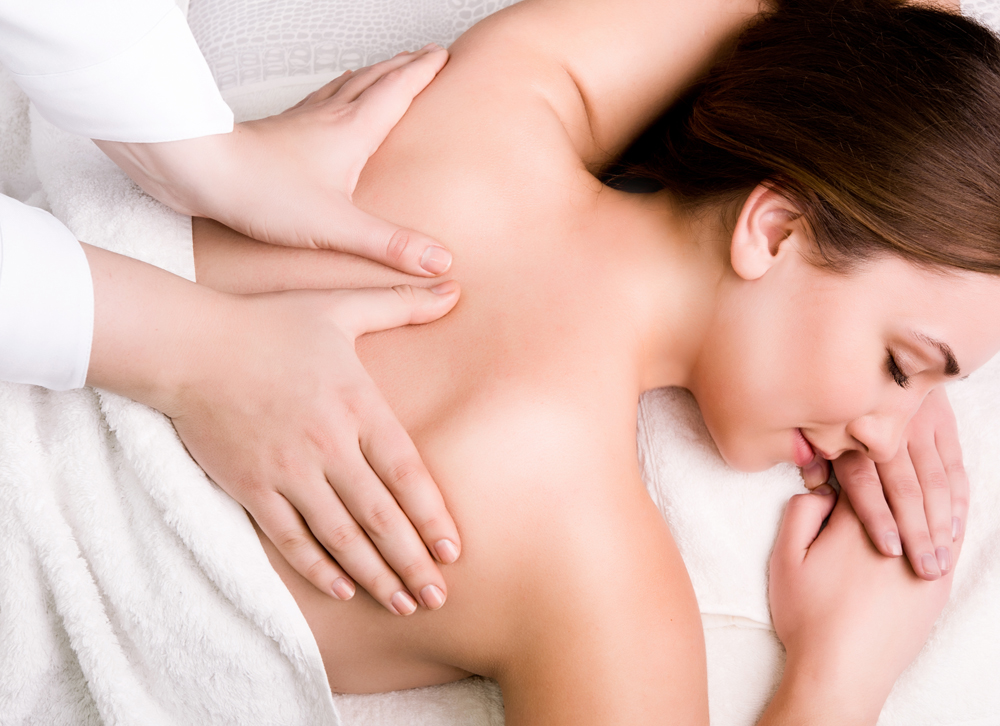 woman getting massage therapy in Roseville